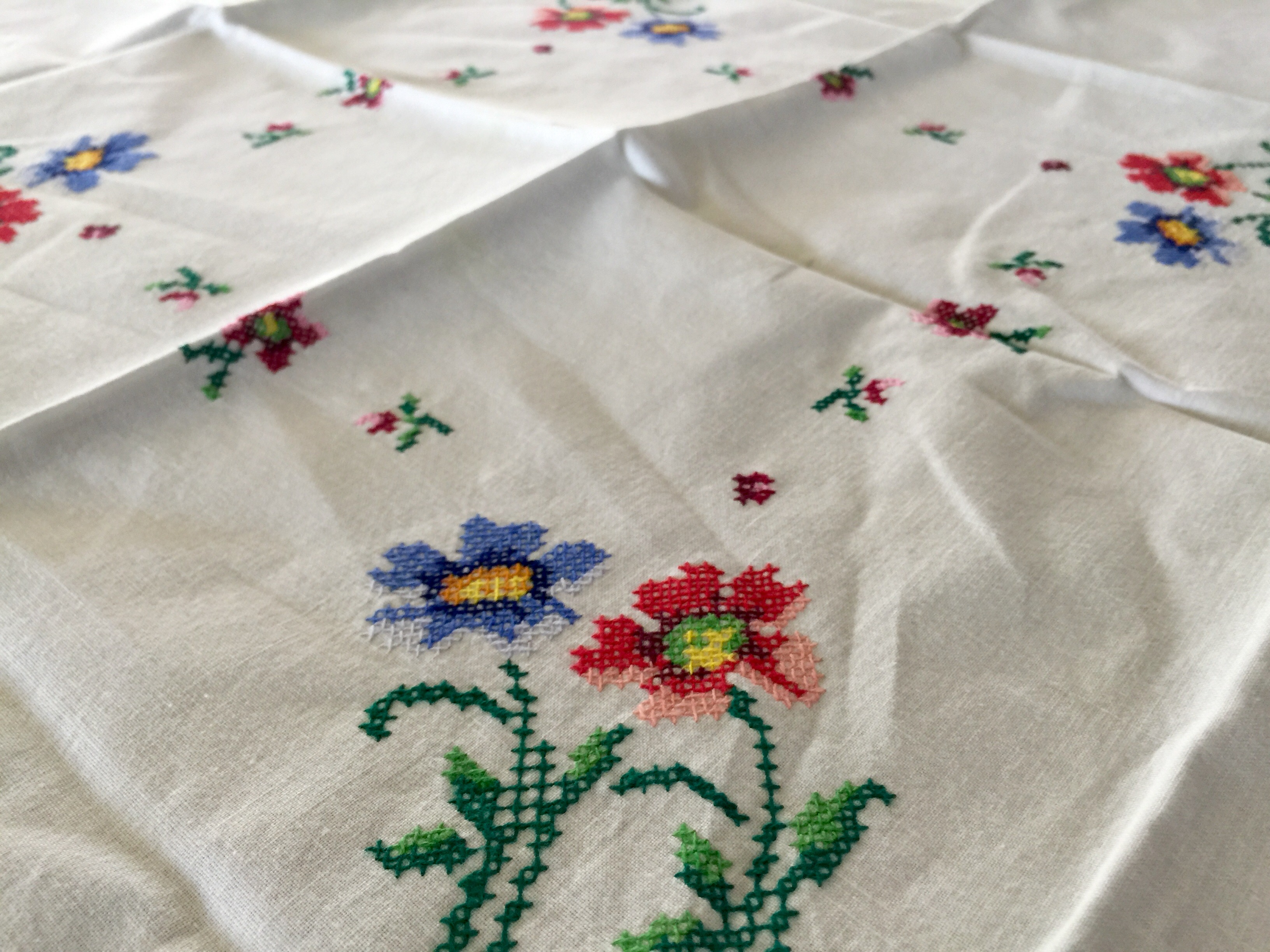 http://foodforayear.com/portfolio/for-sale-by-emily-32-x-32-hand-embroidered-cross-stitch-table-square-28/